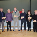 £100 winners receiving their prizes from club chairperson, Gerard Cunnningham